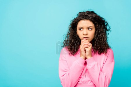 Photo for Worried african american young woman standing isolated on blue - Royalty Free Image