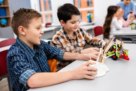 Photo for Pupils sitting at desk with toys during lesson in classroom - Royalty Free Image