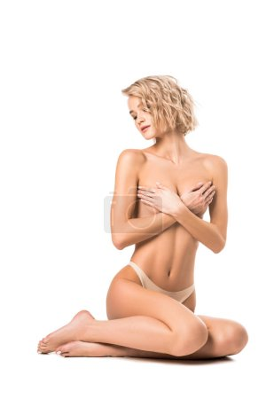 beautiful half-naked young woman covering breasts isolated on white with copy space