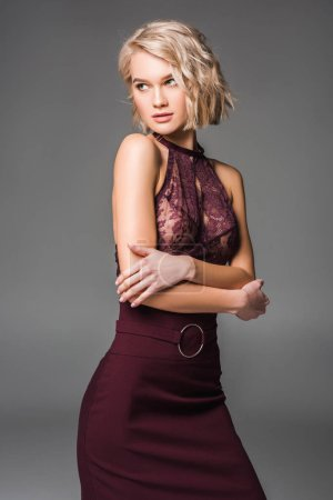 Photo for Beautiful stylish blonde girl in burgundy clothes posing isolated on grey - Royalty Free Image