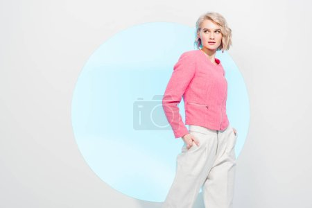 Photo for Beautiful stylish girl posing on white with blue circle and copy space - Royalty Free Image