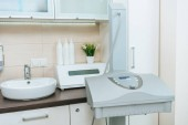 Starvac apparatus with control panel near beauty couch in clinic