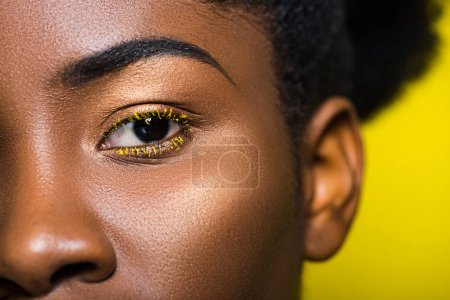 Photo for Cropped view of beautiful african american looking at camera on yellow - Royalty Free Image