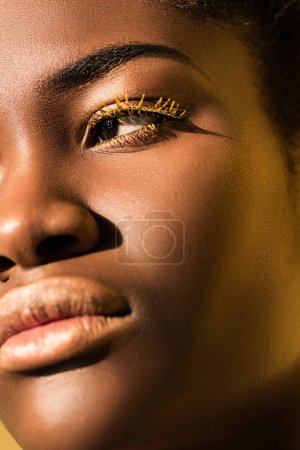 Photo for Cropped view of beautiful african american woman with yellow eyelashes looking away - Royalty Free Image