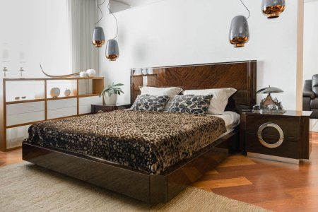 Photo for Interior of modern light bedroom with lamps and brown bedsheets - Royalty Free Image
