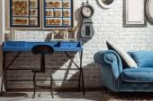 """Постер, картина, фотообои """"Интерьер современный ретро стиле гостиная с кресло, стол, диван и часы на стене"""""""