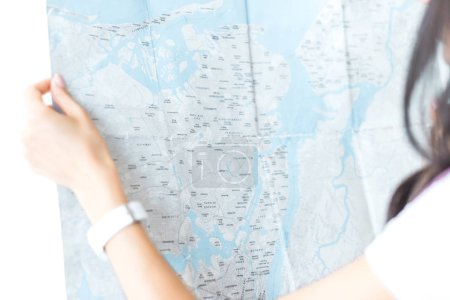 cropped view of female tourist holding map in hands, isolated on white