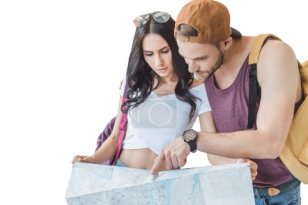 couple of tourists looking at map, isolated on white