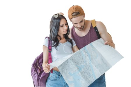two travelers with backpacks looking at map, isolated on white