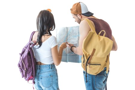 rear view of couple of travelers looking at map, isolated on white
