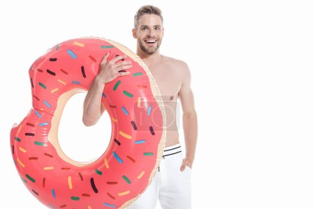 smiling man in swimwear with inflatable donut, isolated on white