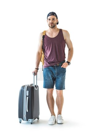 male traveler with suitcase ready for trip, isolated on white