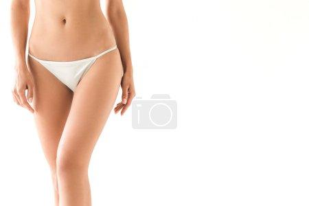 Foto de Vista recortada de la joven mujer delgada posando en bikini blanco, aislado en blanco con espacio de copia - Imagen libre de derechos