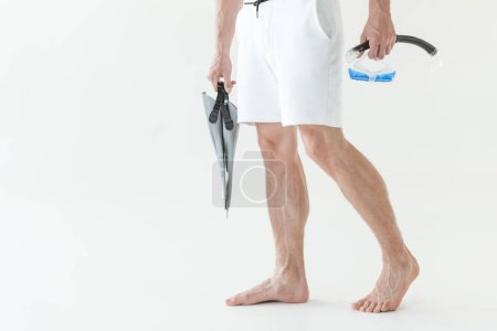 cropped view of man in swimwear with diving mask and snorkel, isolated on white