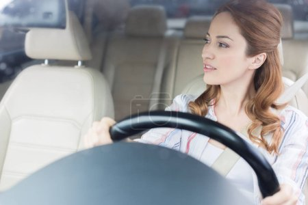 portrait of pensive woman looking away while driving car