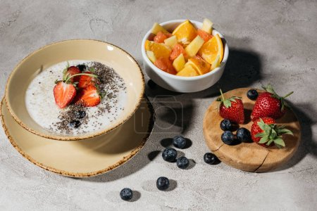 Photo for Healthy breakfast with chia seeds bowl and ripe fruits - Royalty Free Image