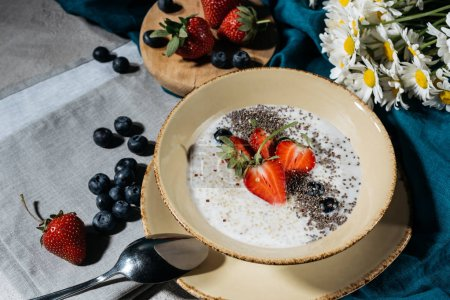 Photo for Chia seeds bowl for breakfast with fresh berries - Royalty Free Image