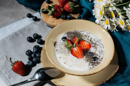 Chia seeds bowl for breakfast with fresh berries