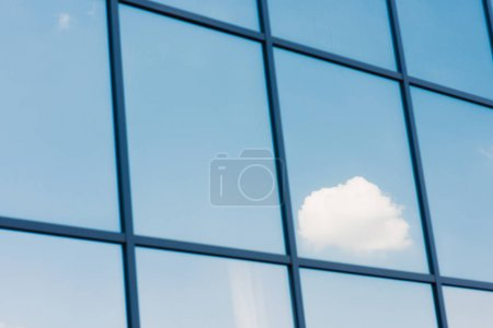 Sky and clouds reflection in the windows of modern office building
