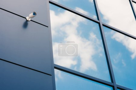Photo for Glass facade of modern office building with security camera - Royalty Free Image