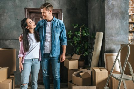 happy young couple moving into new home