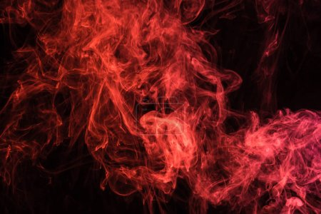 Photo for Red mystical smoke on black background - Royalty Free Image