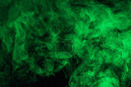 abstract background with green smoke on black
