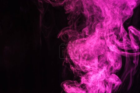 mystical pink smoke on black background