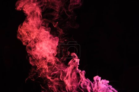 Photo for Pink spiritual smoky swirl on black background with copy space - Royalty Free Image