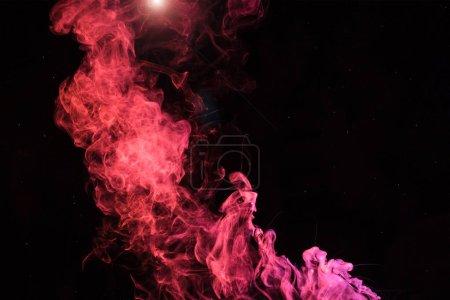 Photo pour Tourbillon de smoky spirituelle rose clair sur fond noir - image libre de droit