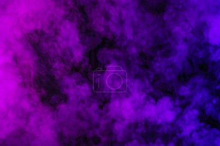 purple smoke on abstract black background