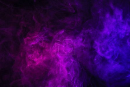 violet smoke on black background with copy space