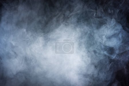 abstract texture with grey smoke on dark background