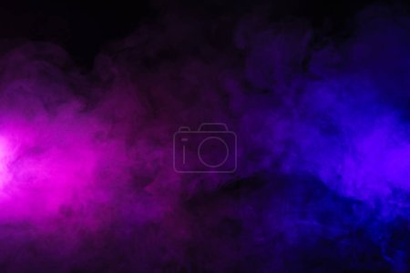 pink and purple smoke on abstract black background
