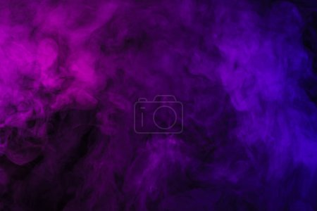 violet and pink smoke on abstract black background