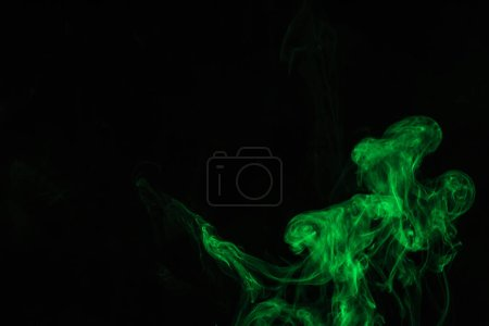 creative black background with green smoke