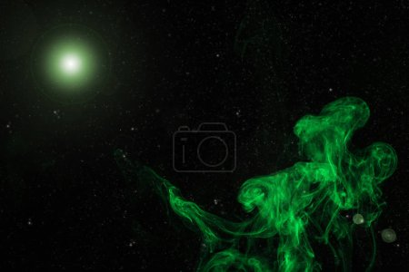 abstract background with green smoke and glowing light on black