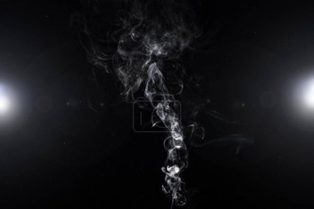 abstract background with white smoky swirl and lights on black