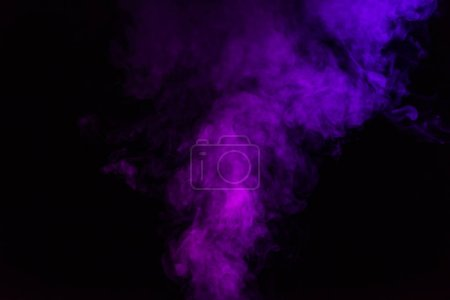 abstract mystical black background with violet smoke