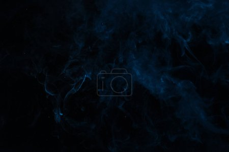 abstract dark smoky texture with blue swirl