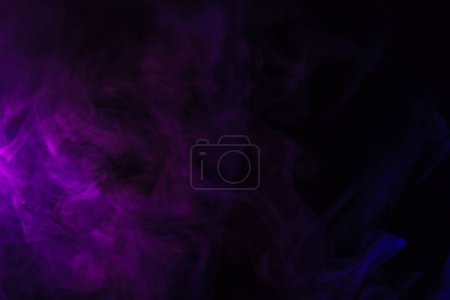 abstract black background with purple smoke, studio shot