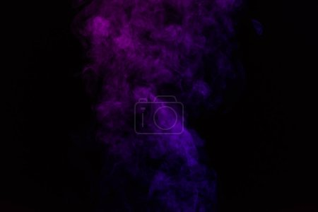 mystical abstract black background with purple smoke
