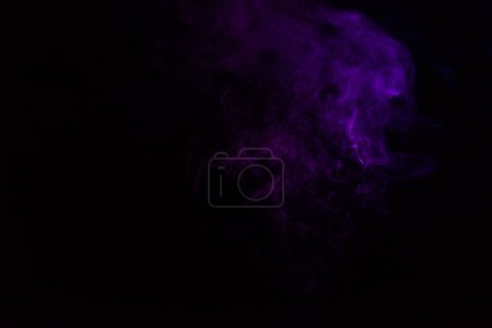 mystical black background with purple smoke