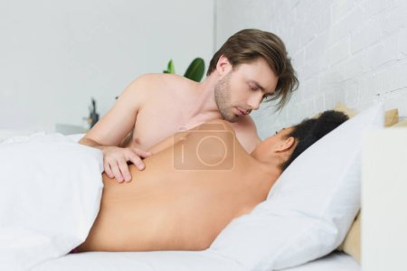 Photo for Partial view of multiethnic young couple in love in bed at home - Royalty Free Image