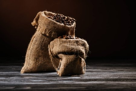 close-up shot of sacks filled with coffee on rustic wooden table