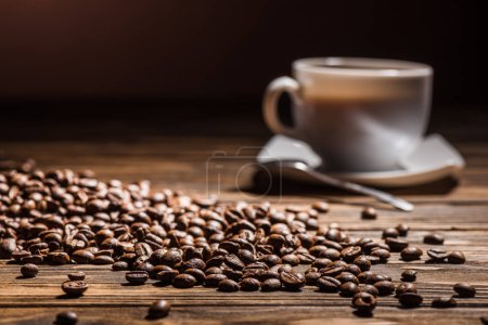 coffee cup on rustic wooden table with spilled coffee beans