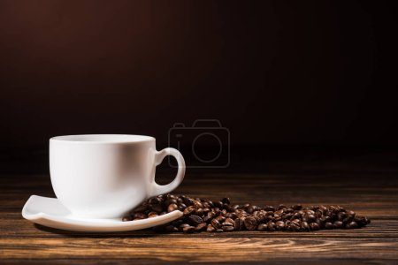 close-up shot heap of coffee beans cup on rustic wooden table