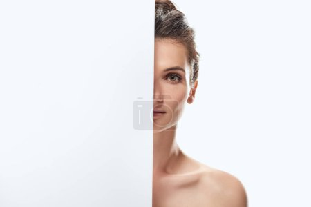 beautiful naked girl posing with empty board, isolated on white