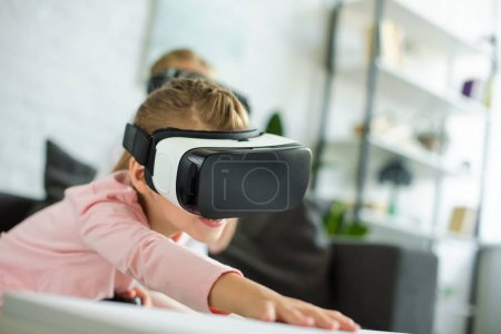 obscured view of little child in virtual reality headset at home