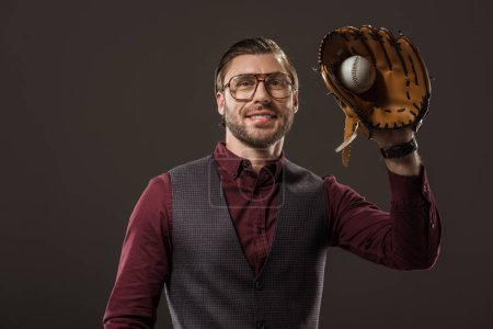 handsome smiling buisnesssman in eyeglasses holding ball with baseball glove isolated on black